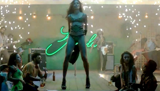 Freida Pinto in Bruno Mars's Gorilla music video.