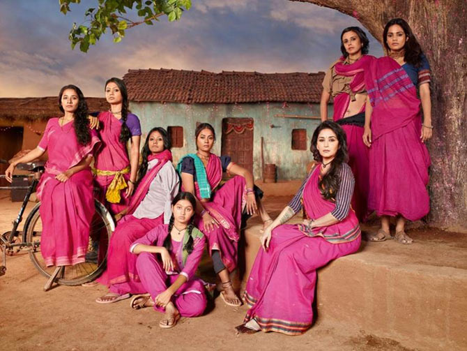 Madhuri Dixit in Gulaab Gang (seated, right)