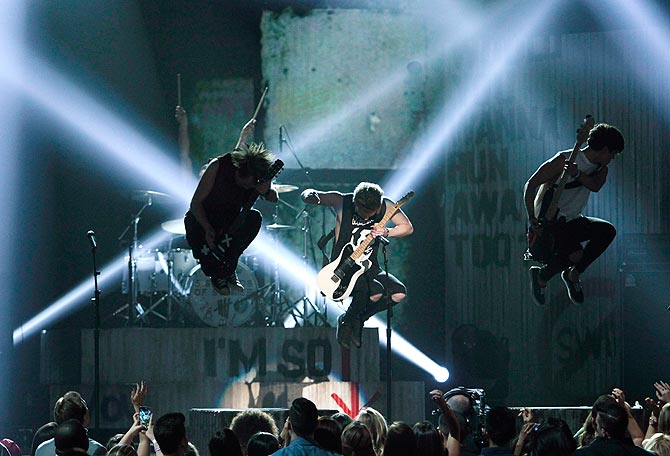5 Seconds of Summer performs on stage