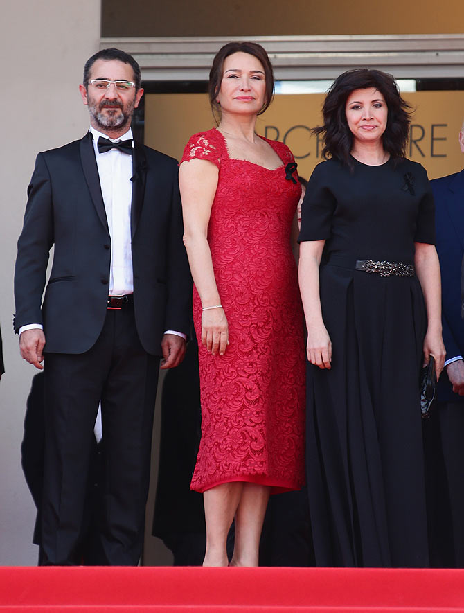 Actress Demet Akbag (center) poses with director Nuri Bilge Ceylan and his wife and the film's co-writer Ebru Ceylan attend the Winter Sleep photocall