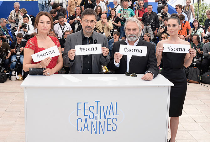 Cast members Demet Akbag, Haluk Bilginer and Melisa Soezen with director Nuri Bilge Ceylan (second from left) attend the Winter Sleep photocall