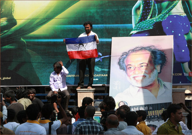 Fans display posters and flags of Rajinikanth