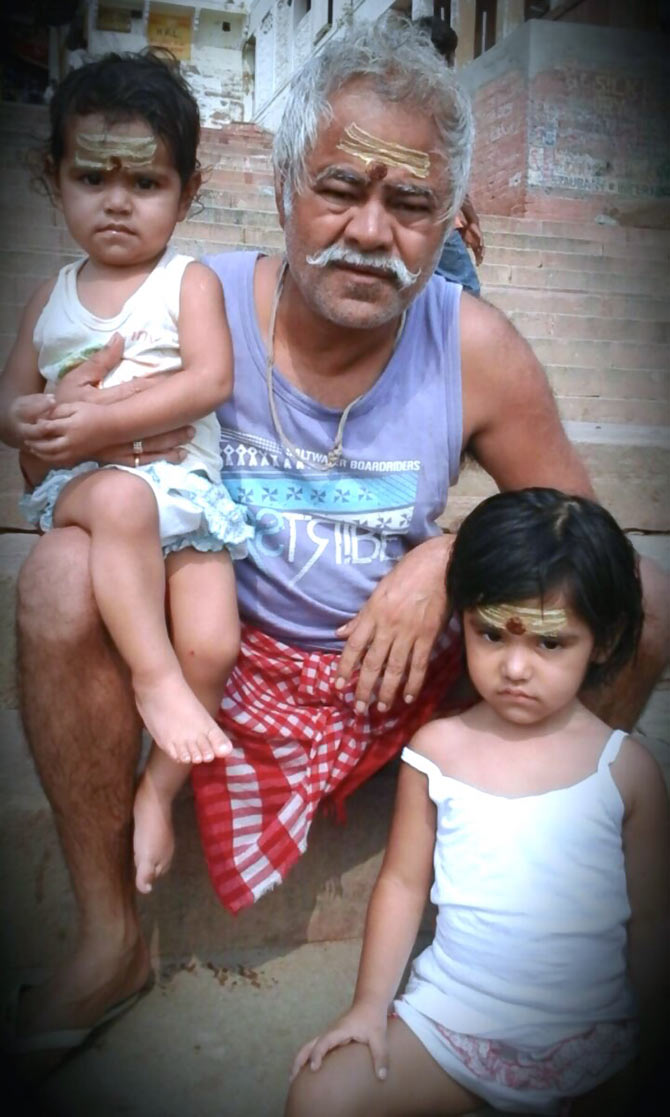 Sanjay Mishra with his daughters