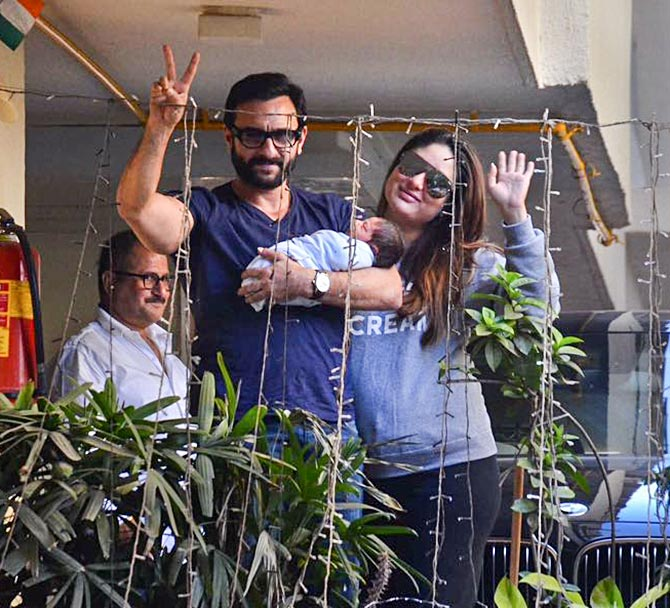 Image result for Kareena and Saif pose with little Taimur outside their house, see pics