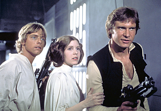 Luke Skywalker, Princess Leia and Han Solo played by Mark Hamill, Carrie Fisher and Harrison Ford in Star Wars, Episode IV: A New Hope (1977).