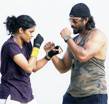 Ritika Singh and R Madhavan in Irudhi Suttru