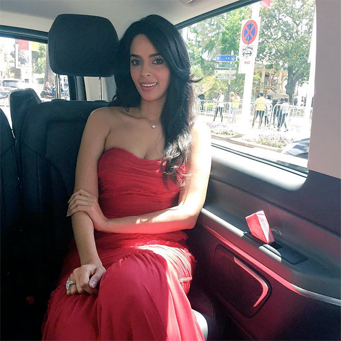 Current Bollywood News & Movies - Indian Movie Reviews, Hindi Music & Gossip - Cannes 2016: Mallika looks elegant in red on Day Two