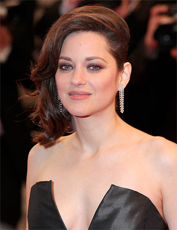 Marion Cotillard reacts to link up rumours with Brad Pitt
