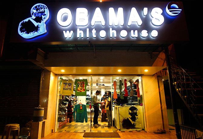 "Customers shop inside an apparel store named ""Obama's white house"" in the western Indian city of Ahmedabad December 3, 2013. Photo: Amit Dave/Reuters"