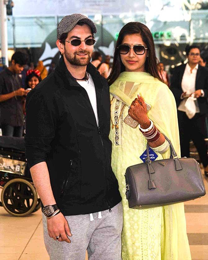 Current Bollywood News & Movies - Indian Movie Reviews, Hindi Music & Gossip - PIX: Newlyweds Neil-Rukmini return to Mumbai
