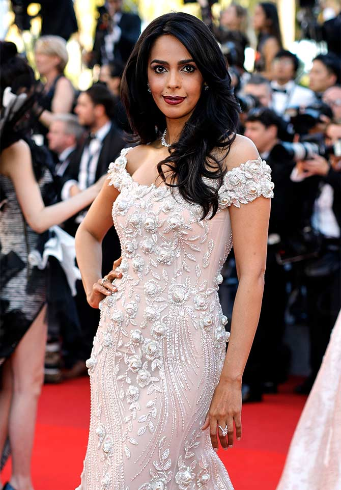 Current Bollywood News & Movies - Indian Movie Reviews, Hindi Music & Gossip - Like Mallika Sherawat's look at Cannes? VOTE!