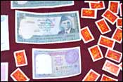 Some of the seized currency and stamps