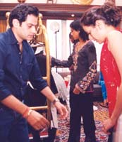 Rathore explaining the steps to a model during a fitting session. Photo: Jewella C Miranda