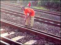 Repairing tracks. Photo: Vijay Singh