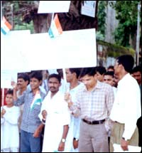 Asrat Ansari holding the national flag