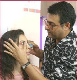 Makeup expert Cory Walia smoothens some blush for model Indrani at a Lakme beauty workshop