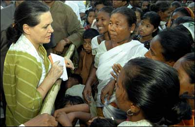 Sonia Gandhi with flood victims