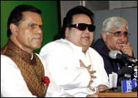 Bappi Lahiri flanked by T Subbirami Reddy and Salman Khurshid