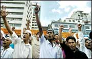 Supporters of an Islamic organisation shout anti-US slogans in Dhaka