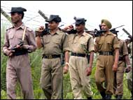 Border Security Force troopers along the fenced India-Bangladesh border in Assam
