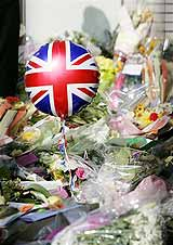 A balloon with a Union flag design in an area set aside for floral tributes beside King's Cross station in London, for victims of the last week's London bombings. AP Photo/Matt Dunham
