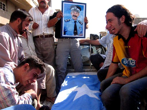 Relatives cry during a funeral of Brig.Sabah Qara Alton, a Turkman official who was shot dead in  Kirkuk City June 3. (AP Photo)
