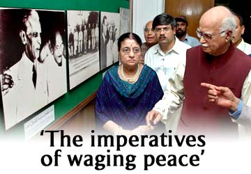 BJP chief LK Advani, right, and his wife Kamla look a picture of Quaid-e-Azam, Mohammad Ali Jinnah, the founder of Pakistan, at a museum during his visit to Karachi, Pakistan on Saturday, June 4, 2005. AP Photo/Adnan Ali