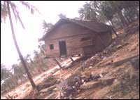 This tilted house below is the only one which survived the fury of tsunami waves in the village