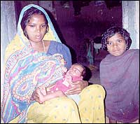 HIV positive Kisya Devi with her children. Her husband passed on the disease to her before he died. Newborn Hirwa is also suspected to be HIV positive.