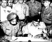 Pakistan Army Lt General A K Niazi signing the document of surrender with India's Lt General J S Arora