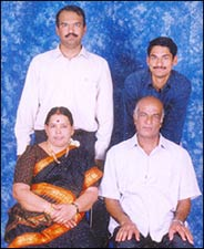 Nagarajan (standing, in white shirt) with Sunderrajan and their parents.