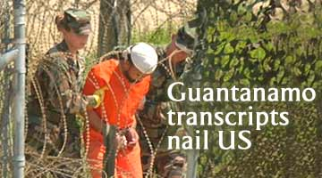 A detainee is escorted for interrogation by US military guards at Camp X-Ray,  Guantanamo Bay US Naval Base, Cuba (AP File photo)