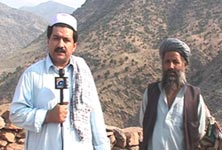 Hamid Mir stands near the graves of four bodyguards of Osama Bin Laden at a mountain top in Tora Bora, where US forces hunted in vain for the Al Qaeda leader in December 2001. Behind Mir is local Hizb-e-Islami commander Ghayas. Photograph courtesy Hamid Mir