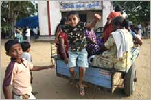 Sri Lankan Tamil refugee children arrive at the Sacred Heart Church in Mutur, near Trinconamalee, Sri Lanka