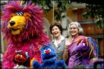 "US First lady Laura Bush, (C), stand with Nafisa Ali, chairperson of the Children's Film Society of India as they meet the cast of the Indian version of the children's TV show Sesame Street, called ""Galli Galli Sim Sim"", at their film studio on the outskirts of New Delhi."
