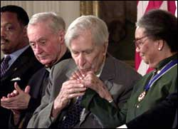 Galbraith  kisses the hand of Marian Wright Edelman, president, Children's Defense Fund, after receiving the Presidential Medal of Freedom, the highest American civilian award, in the East Room of the White House August 9, 2000. Photograph: Tim Sloan/AFP/Getty Images