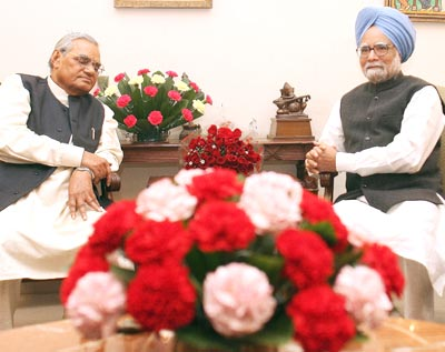 Prime Minister Manmohan Singh wishes Senior BJP leader Atal Bihari Vajpayee on his 84th birthday in New Delhi on Tuesday