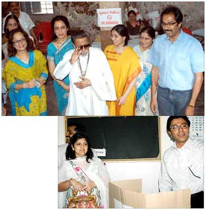 Shiv Sena chief Bal Thackeray with his family and son Udhav. Inset: Raj Thackeray.