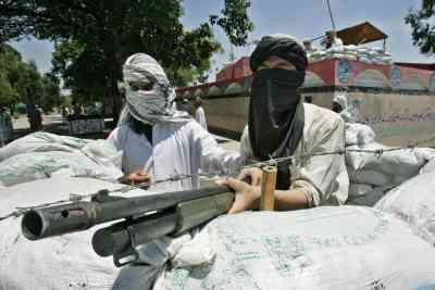 Militant students of the Lal Masjid take aim as they exchange fire with security forces.
