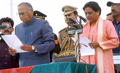 Mayawati being administered the oath