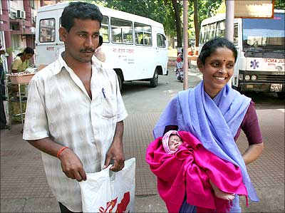 Ramu Chauhan with his wife Viju and infant Goli outside the Cama hospital