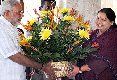 Gujarat Chief Minister Narendra Modi presents a bouquet to AIADMK Supremo J Jayalalithaa at her residence in Chennai