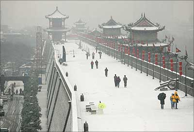 Tourists at the South Gate of the Xian City Wall after a snow storm in Xian at Shaanxi Province in China