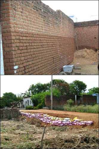 (Top) The infamous wall and the newly constructed path