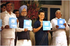 United we stand: T R Baalu, Dr Manmohan Singh, Sonia Gandhi and Lalu Yadav after the UPA released its 4th year report card