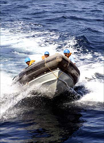 Naval commandos plough through the sea during a mock drill off the Porbandar coast