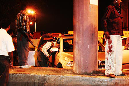Police examine the Skoda after Kasab was captured