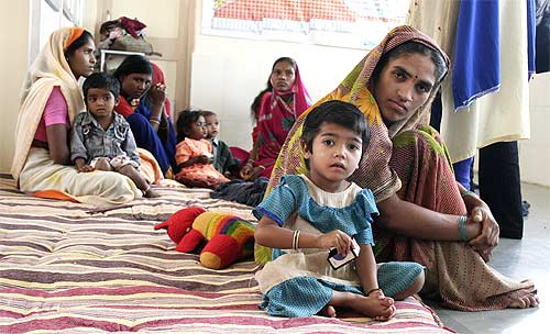 Mothers with children at the makeshift government day care centre in a yet to be inaugurated hospital at Churni in Amravati district of Maharashtra.