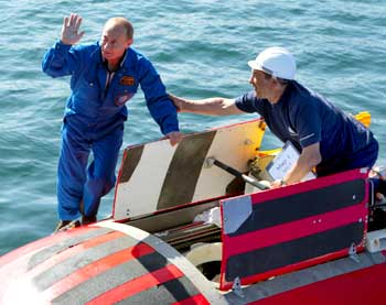 Putin waves onboard the Mir-2 mini-submersible at Lake Baikal
