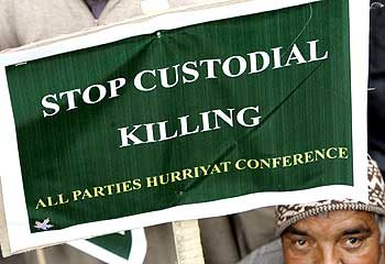 An activist holds a placard to mark the World Human Rights Day in Srinagar